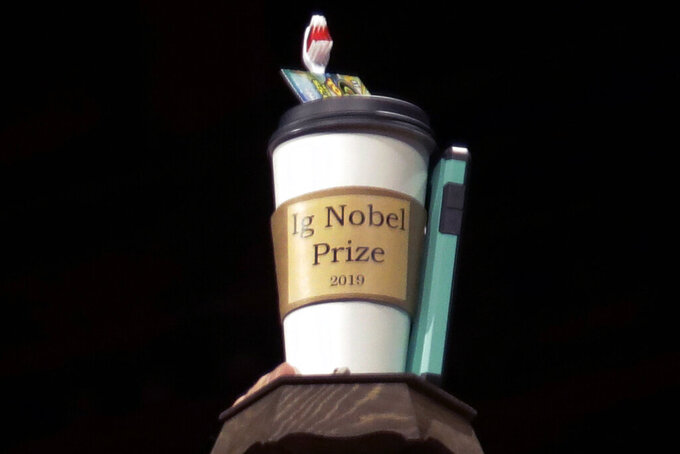 FILE - In this Sept. 12, 2019 file photo, the 2019 Ig Nobel award is displayed at the 29th annual Ig Nobel awards ceremony at Harvard University in Cambridge, Mass. The spoof prizes for weird and sometimes head-scratching scientific achievement will be presented online in 2021 due to the coronavirus pandemic. (AP Photo/Elise Amendola, File)