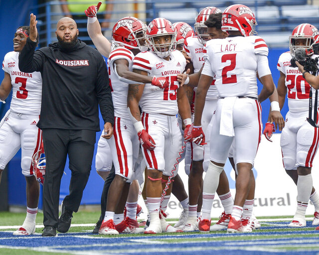 Louisiana running back Elijah Mitchell (15) is surrounded by teammates after he scores the winning touchdown in an overtime play against Georgia State in an NCAA college football game, Saturday, Sept. 19, 2020, in Atlanta. (Daniel Varnado/Atlanta Journal-Constitution via AP)