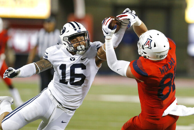 BYU  linebacker Sione Takitaki (16) breaks up a pass intended for Arizona tight end Bryce Wolma (81) during the first half of an NCAA college football game Saturday, Sept. 1, 2018, in Tucson, Ariz. (AP Photo/Rick Scuteri)