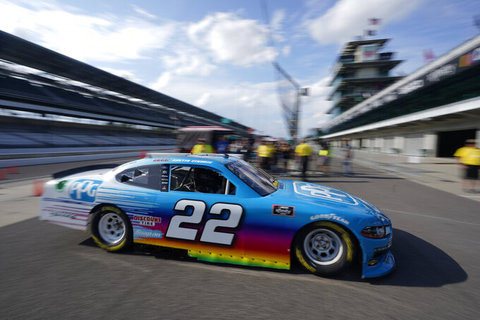 Austin Cindric pulls into Gasoline Alley during practice for the NASCAR Xfinity Series auto race at Indianapolis Motor Speedway, Friday, Aug. 13, 2021, in Indianapolis. (AP Photo/Darron Cummings)