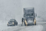 Several cars and tractor-trailers get stuck in the snow on Route 9, in Marlboro, Vt., as several inches of snow falls on Friday, April 16, 2021. (Kristopher Radder/The Brattleboro Reformer via AP)