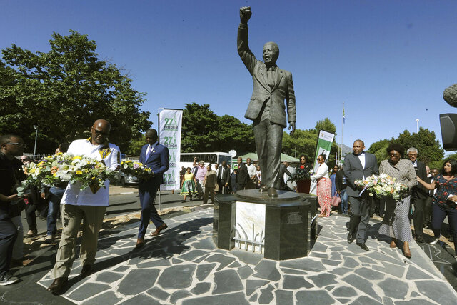 Wreaths are laid at a statue of former President Nelson Mandela at the entrance to the Victor Verster prison in Paarl, South Africa, Tuesday, Feb. 11, 2020. Thirty years ago, Nelson Mandela was released from 27 years of imprisonment at Victor Verster prison by South Africa's apartheid regime and instantly galvanized the country, and the world, to dismantle the brutal system of racial oppression. (AP Photo/Nasief Manie)