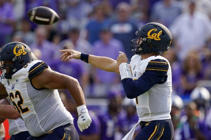 California offensive lineman Ben Coleman (62) defends at the line as quarterback Chase Garbers, right, throws a pass in the second half of an NCAA college football game against TCU in Fort Worth, Texas, Saturday, Sept. 11, 2021. (AP Photo/Tony Gutierrez)