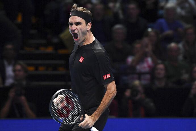 Roger Federer of Switzerland celebrates the winning match point against Novak Djokovic of Serbia during their ATP World Tour Finals singles tennis match at the O2 Arena in London, Thursday, Nov. 14, 2019. (AP Photo/Alberto Pezzali)