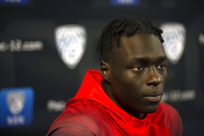 FILE - Utah's Both Gach speaks during the Pac-12 NCAA college basketball media day in San Francisco, in this Tuesday, Oct. 8, 2019, file photo. Gach switched schools to be closer to his family during the COVID-19 pandemic. Now at Minnesota, junior guard Both Gach has been granted immediate eligibility by the NCAA. (AP Photo/D. Ross Cameron, File)