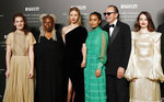 From left, Stella Roversi, American actress Whoopi Goldberg, British model Mia Goth, American model Yara Shahidi, Italian photographer Paolo Roversi and British actress Claire Foy pose for photographers at the 2020 Pirelli Calendar event in Verona, Italy, Tuesday, Dec. 3, 2019. (AP Photo/Antonio Calanni)