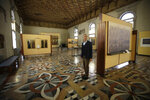 Giulio Manieri Elia, Director of the Accademia Gallery stands in one of the rooms of the gallery during an interview with the Associated Press, in Venice, Saturday, Nov. 16, 2019. As high tidal waters returned to Venice on Saturday, four days after the city experienced its worst flooding in 50 years, young Venetians are responding to the worst flood in their lifetimes by volunteering to help salvage manuscripts, clear out waterlogged books and lend a hand where needed throughout the stricken city. (AP Photo/Luca Bruno)