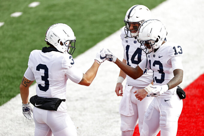 Penn State wide receiver Parker Washington (3) is congratulated after scoring a touchdown by wide receiver KeAndre Lambert-Smith (13) and quarterback Sean Clifford during the first half of an NCAA college football game against Rutgers on Saturday, Dec. 5, 2020, in Piscataway, N.J. (AP Photo/Adam Hunger)