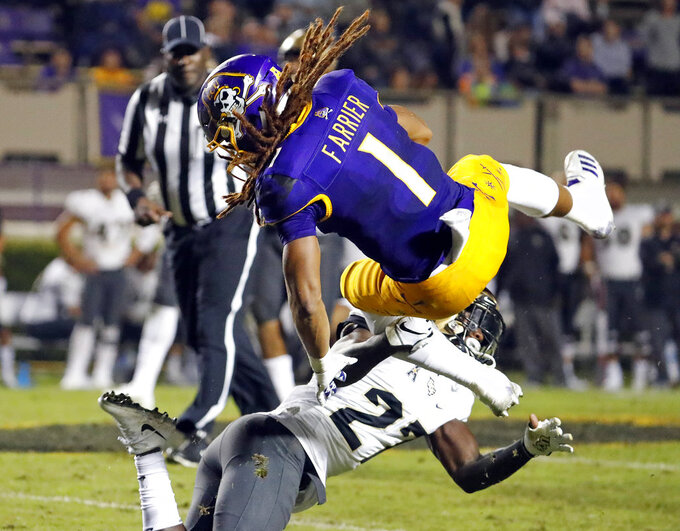 East Carolina's Deondre Farrier (1) collides with Central Florida's Richie Grant (27) during the second half of an NCAA college football game in Greenville, N.C., Saturday, Oct. 20, 2018. UCF won 37-10. (AP Photo/Karl B DeBlaker)