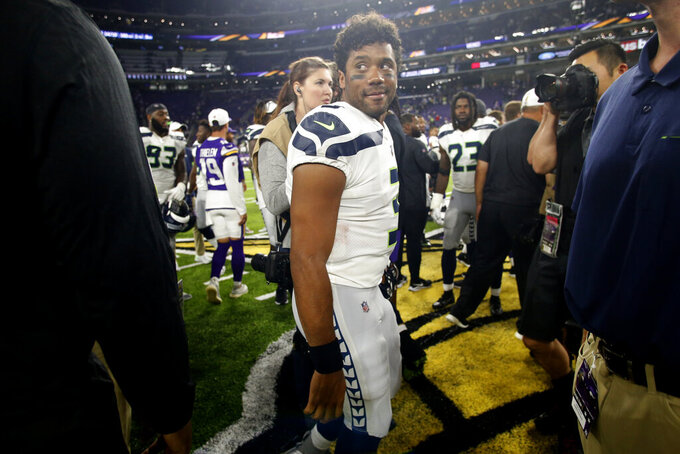 Seattle Seahawks quarterback Russell Wilson walks off the field after an NFL preseason football game against the Minnesota Vikings, Sunday, Aug. 18, 2019, in Minneapolis. The Vikings won 25-19. (AP Photo/Bruce Kluckhohn)