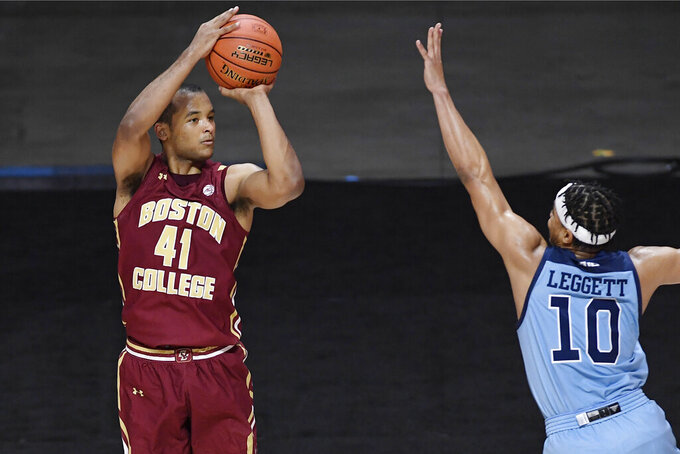 Boston College's Steffon Mitchell goes up for 3-point against Rhode Island's Ishmael Leggett during the first half of an NCAA college basketball game Thursday, Nov. 26, 2020, in Uncasville, Conn. (AP Photo/Jessica Hill)