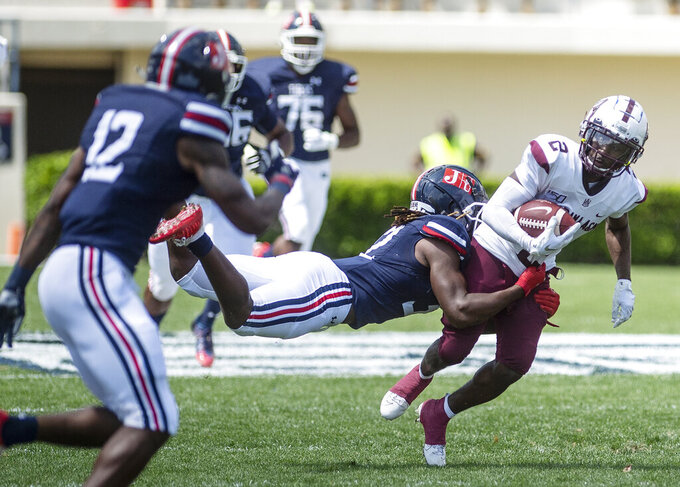 Jackson State's Javien Adams (32) tries to stop Alabama A&M's Brian Jenkins Jr. (2) during an NCAA college football game, Saturday, April 10, 2021, at Veterans Memorial Stadium in Jackson, Miss. (Eric Shelton/The Clarion-Ledger via AP)