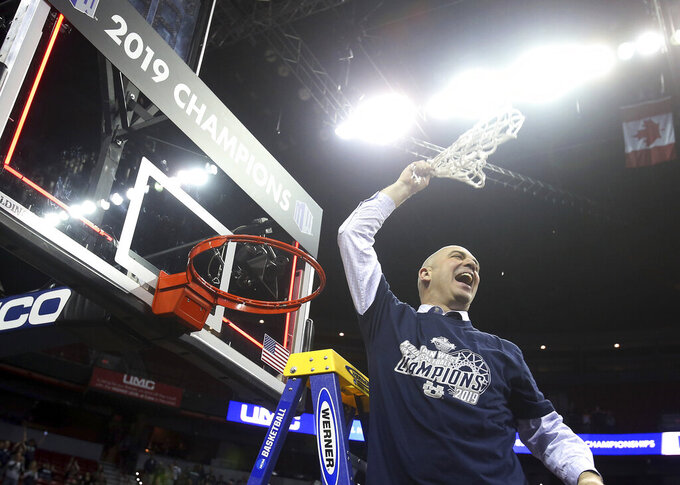 Utah State's head coach Craig Smith swings the net after defeating San Diego State in an NCAA college basketball game in the Mountain West Conference men's tournament championship Saturday, March 16, 2019, in Las Vegas. (AP Photo/Isaac Brekken)