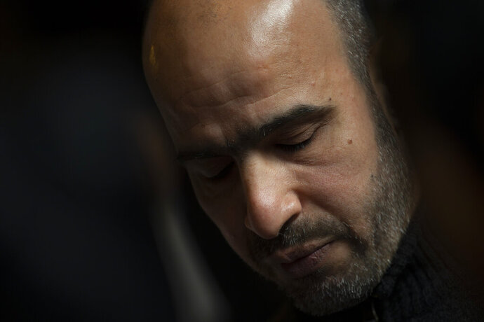 Dutch-Palestinian man Ismail Zeyada, originally from the Gaza Strip, pauses as he reads a statement after The Hague District Court, Netherlands, Wednesday, Jan. 29, 2020, threw out the case in which Zeyada sought to sue Benny Gantz, former Chief of Staff of the Israel Defense Forces, and another Israeli military commander over their roles in an air strike that killed six members of his family. (AP Photo/Peter Dejong)