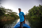 White River Fish Sanctuary warden and diver Everton Simpson heads out to sea to patrol against illegal fishing at dawn in White River, Jamaica, Tuesday, Feb. 12, 2019. Once a spear fisherman and later a scuba-diving instructor, Simpson started working as a