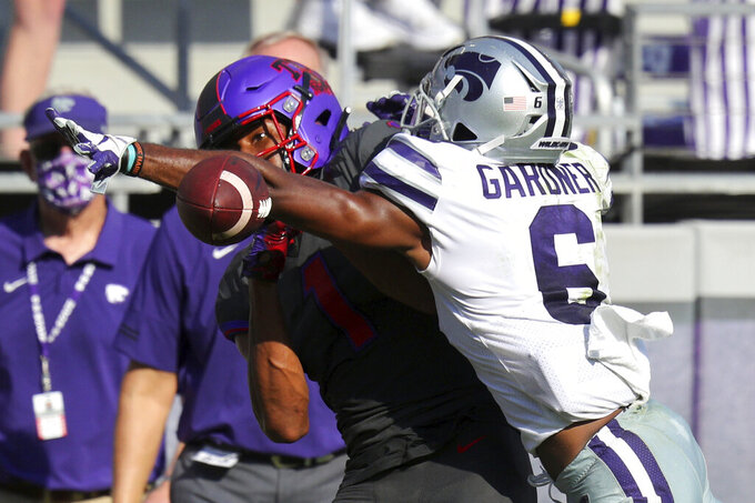 Kansas State defensive back Justin Gardner (6) breaks up a pass to TCU wide receiver Quentin Johnston (1) in the second quarter of an NCAA college football game Saturday, Oct. 10, 2020, in Arlington, Texas. (AP Photo/Richard W. Rodriguez)
