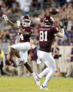 Texas A&M wide receiver Camron Buckley (14) watches as tight end Jace Sternberger (81) catches the pass intended for him, which Sternberger ran in for a touchdown against Kentucky during the second half of an NCAA college football game Saturday, Oct. 6, 2018, in College Station, Texas. (AP Photo/Michael Wyke)