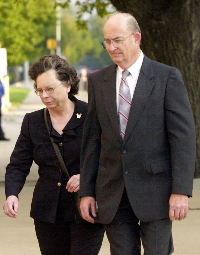 FILE - In this Oct. 5, 2005 file photo, Arlan and Linda Kaufman walk to the federal courthouse in Wichita, Kan., for their trial on several federal charges including servitude. A federal judge has refused to free Arlan Kaufman who once enslaved mentally ill patients in Kansas and forced them to work naked and engage in sexual acts, while billing the government and their families for the therapy. U.S. District Judge J. Thomas Marten cited the