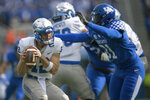 Kentucky wide receiver Darren Edmond (31) pressures Middle Tennessee quarterback Brent Stockstill (12) during the first half of an NCAA college football game in Lexington, Ky., Saturday, Nov. 17, 2018. (AP Photo/Bryan Woolston)