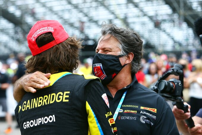 Andretti Autosport team owner Michael Andretti, right, congratulates his driver Colton Herta after winning the Grand Prix of St. Petersburg, Sunday, April 25, 2021 in St. Petersburg, Fla. (Luis Santana/Tampa Bay Times via AP)