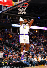 Los Angeles Lakers forward LeBron James dunks against the Denver Nuggets during the first quarter an NBA basketball game Tuesday, Dec. 3, 2019, in Denver. (AP Photo/Jack Dempsey)