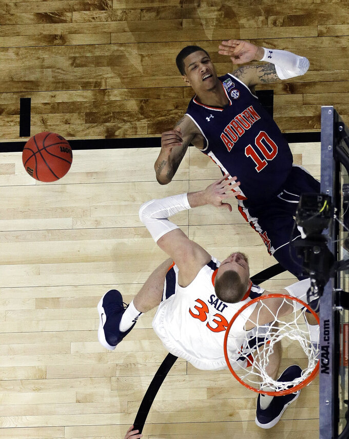 Auburn's Samir Doughty (10) and tv33n= battle for a rebound during the first half in the semifinals of the Final Four NCAA college basketball tournament, Saturday, April 6, 2019, in Minneapolis. (AP Photo/David J. Phillip)