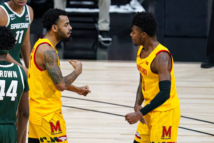 Maryland guard Eric Ayala (5) celebrates with guard Hakim Hart (13) after being fouled on a shot against Michigan State in the second half of an NCAA college basketball game at the Big Ten Conference tournament in Indianapolis, Thursday, March 11, 2021. (AP Photo/Michael Conroy)