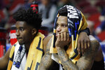 Montana guard Ahmaad Rorie sits on the bench with teammate Michael Oguine, left, at the end of a first round men's college basketball game against Michigan in the NCAA Tournament, Thursday, March 21, 2019, in Des Moines, Iowa. Michigan won 74-55. (AP Photo/Charlie Neibergall)