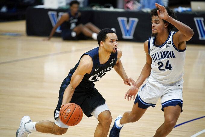 Butler's Jair Bolden, left, tries to dribble past Villanova's Jeremiah Robinson-Earl during the first half of an NCAA college basketball game, Wednesday, Dec. 16, 2020, in Villanova, Pa. (AP Photo/Matt Slocum)
