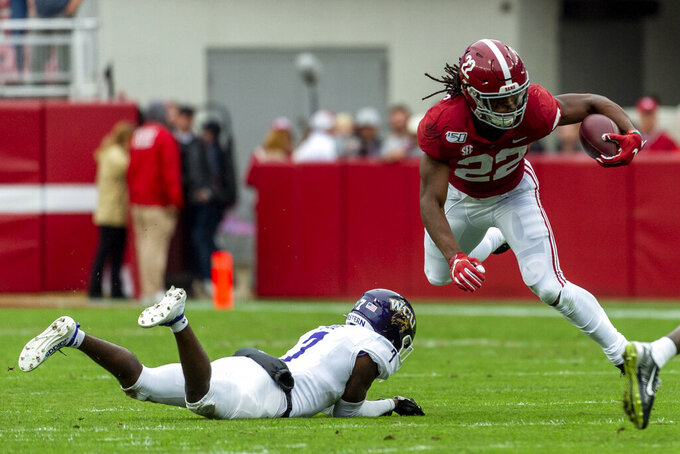 Alabama running back Najee Harris (22) runs by Western Carolina defensive back Charles Gadie (7) during the first half of an NCAA college football game, Saturday, Nov. 23, 2019, in Tuscaloosa, Ala. (AP Photo/Vasha Hunt)