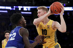 Marquette forward Sam Hauser, right, is defended by Seton Hall guard Myles Cale (22) during the first half of an NCAA college basketball semifinal game in the Big East men's tournament, Friday, March 15, 2019, in New York. (AP Photo/Julio Cortez)