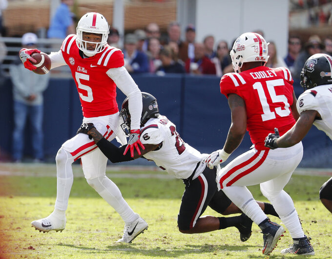 Mississippi wide receiver DaMarkus Lodge (5) fights off a South Carolina defender for short yardage during the second half of an NCAA college football game, Saturday, Nov. 3, 2018, in Oxford, Miss. South Carolina won 44-41. (AP Photo/Rogelio V. Solis)
