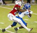 Florida Atlantic cornerback Zyon Gilbert (24) wraps up Memphis wide receiver Tahj Washington (18) in the Montgomery Bowl NCAA college football game in Montgomery, Ala., Wednesday, Dec. 23, 2020. (Mickey Welsh/The Montgomery Advertiser via AP)
