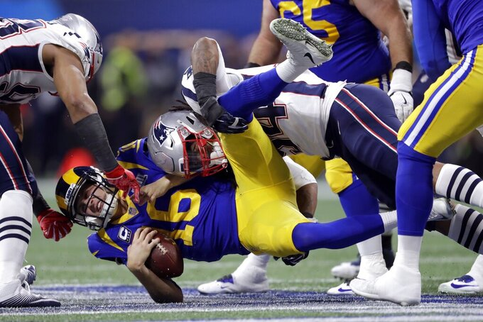 New England Patriots' Dont'a Hightower, top, sacks Los Angeles Rams' Jared Goff (16) during the first half of the NFL Super Bowl 53 football game Sunday, Feb. 3, 2019, in Atlanta. (AP Photo/John Bazemore)
