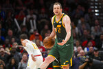 Utah Jazz forward Joe Ingles reacts after a referee's call during the first half of an NBA basketball game Thursday, March 21, 2019, in Atlanta. (AP Photo/John Amis)