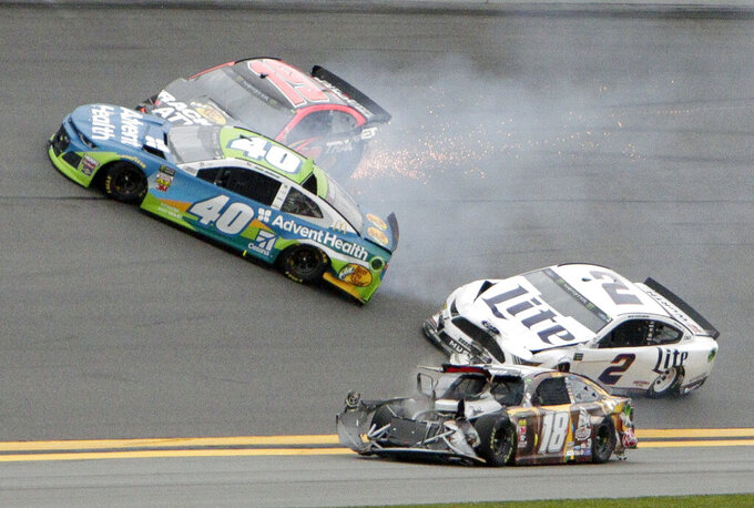 Jamie McMurray (40), Martin Truex Jr. (19), Brad Keselowski (2) and Kyle Busch (18) get caught up in a multi-car crash during the NASCAR Clash auto race at Daytona International Speedway, Sunday, Feb. 10, 2019, in Daytona Beach, Fla. (AP Photo/Darryl Graham)