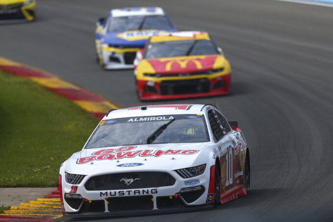 Aric Almirola (10) turns to the Esses during a NASCAR Cup Series auto race in Watkins Glen, N.Y., on Sunday, Aug. 8, 2021. (AP Photo/Joshua Bessex)