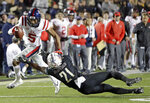 Mississippi wide receiver DaMarkus Lodge (5) gets past Vanderbilt cornerback Donovan Sheffield (21) in the first half of an NCAA college football game Saturday, Nov. 17, 2018, in Nashville, Tenn. (AP Photo/Mark Humphrey)