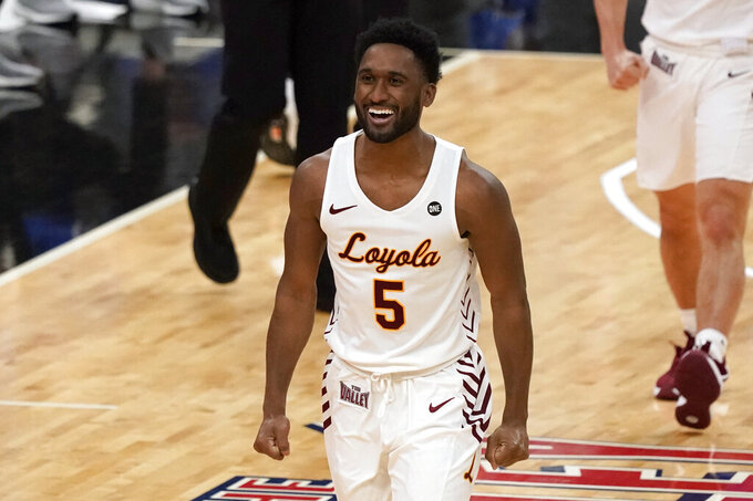 Loyola of Chicago's Keith Clemons (5) celebrates during the first half of the championship game against Drake in the NCAA Missouri Valley Conference men's basketball tournament Sunday, March 7, 2021, in St. Louis. (AP Photo/Jeff Roberson)