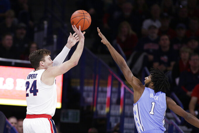Gonzaga forward Corey Kispert (24) shoots over North Carolina guard Leaky Black (1) during the first half of an NCAA college basketball game in Spokane, Wash., Wednesday, Dec. 18, 2019. (AP Photo/Young Kwak)
