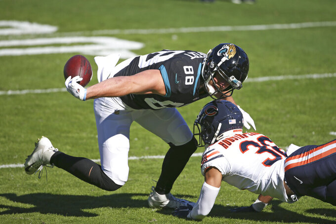Chicago Bears safety DeAndre Houston-Carson, right, breaks up a pass intended for Jacksonville Jaguars tight end Tyler Eifert (88) during the first half of an NFL football game, Sunday, Dec. 27, 2020, in Jacksonville, Fla. (AP Photo/Stephen B. Morton)