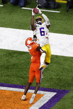 LSU wide receiver Terrace Marshall Jr. catches a touchdown pass over Clemson cornerback Derion Kendrick during the second half of a NCAA College Football Playoff national championship game Monday, Jan. 13, 2020, in New Orleans. (AP Photo/Eric Gay)