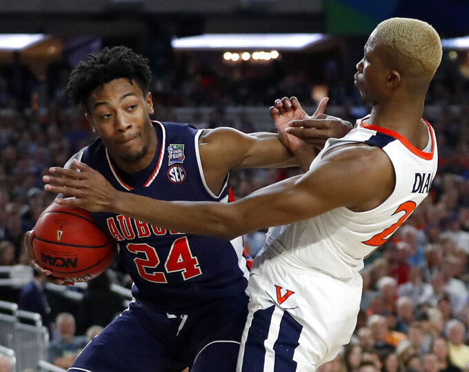 Auburn's Anfernee McLemore (24) battles for a loose ball against Virginia's Mamadi Diakite (25) during the second half in the semifinals of the Final Four NCAA college basketball tournament, Saturday, April 6, 2019, in Minneapolis. (AP Photo/Jeff Roberson)