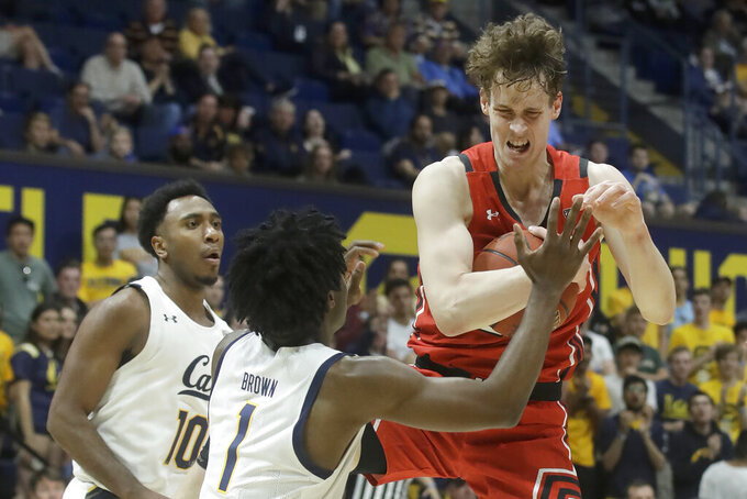 Utah forward Mikael Jantunen, right, grabs a rebound against California guard Joel Brown (1) and guard Kareem South (10) during the first half of an NCAA college basketball game in Berkeley, Calif., Saturday, Feb. 29, 2020. (AP Photo/Jeff Chiu)