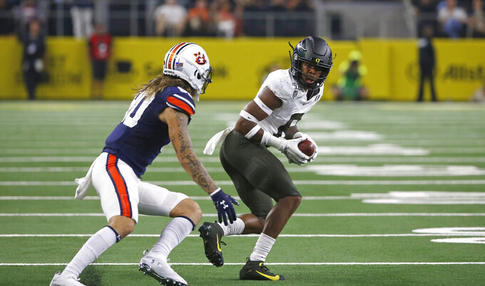 Oregon safety Jevon Holland (8) intercepts a pass in front of Auburn wide receiver Sal Cannella (80) during the first half of an NCAA college football game, Saturday, Aug. 31, 2019, in Arlington, Texas. (AP Photo/Ron Jenkins)