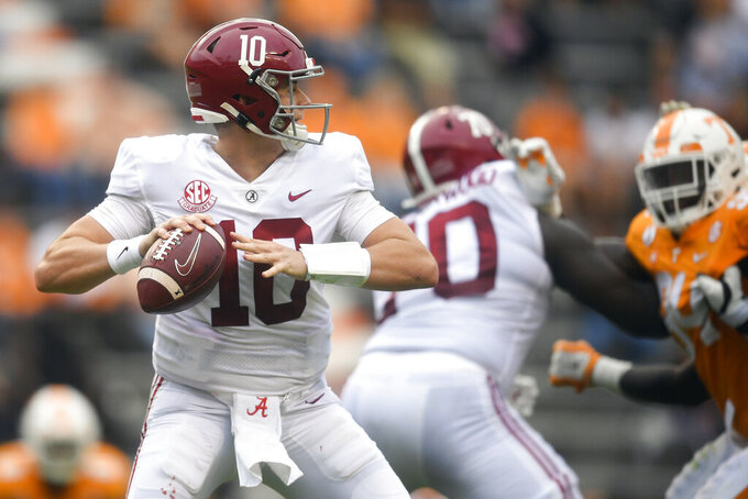 Alabama quarterback Mac Jones (10) lines up a pass against Alabama during an NCAA college football game in Knoxville, Tenn., Saturday, Oct. 24, 2020. (Caitie McMekin/Knoxville News Sentinel via AP)