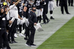 Las Vegas Raiders head coach Jon Gruden motions to his players during the first half of an NFL football game against the New Orleans Saints, Monday, Sept. 21, 2020, in Las Vegas. (AP Photo/Isaac Brekken)