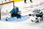San Jose Sharks goaltender Martin Jones (31) defends a shot by Los Angeles Kings right wing Alex Iafallo (19) during the third period of an NHL hockey game in San Jose, Calif., Monday, March 22, 2021. (AP Photo/Jeff Chiu)