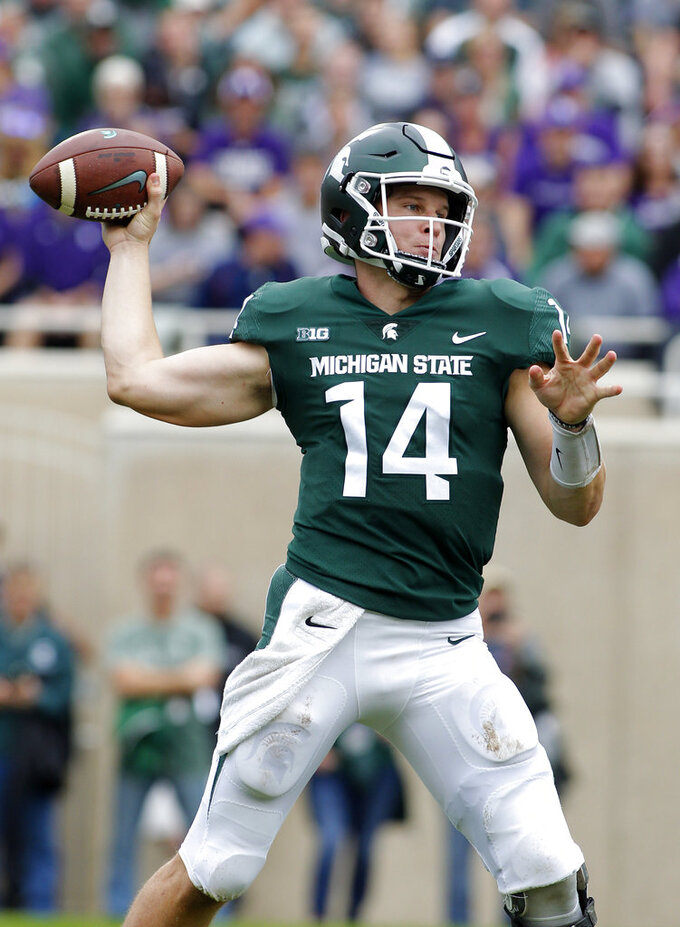 Michigan State quarterback Brian Lewerke throws a pass against Northwestern during the second quarter of an NCAA college football game, Saturday, Oct. 6, 2018, in East Lansing, Mich. (AP Photo/Al Goldis)
