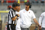 Texas Tech coach Matt Wells argues a call with head linesman Matt Burks during the first half of the team's NCAA college football game against Texas Tech, Saturday, Sept. 11, 2021, in Lubbock, Texas. (AP Photo/Brad Tollefson)